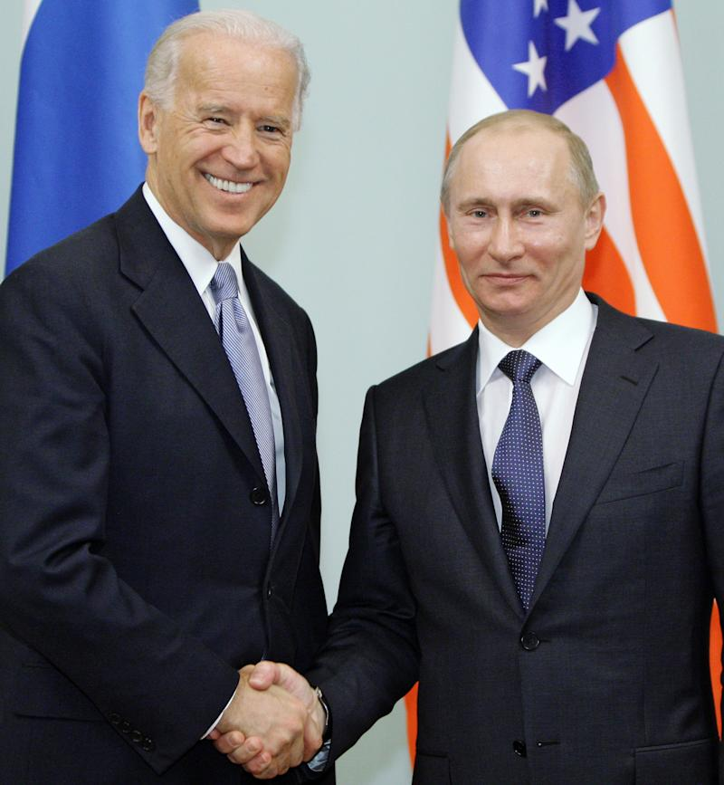 Vice President of the United States Joe Biden, left, shakes hands with Russian Prime Minister Vladimir Putin in Moscow, Russia, Thursday, March 10, 2011. The talks in Moscow are expected to focus on missile defense cooperation and Russia's efforts to join the World Trade Organization. (AP Photo/RIA Novosti, Alexei Druzhinin, pool)