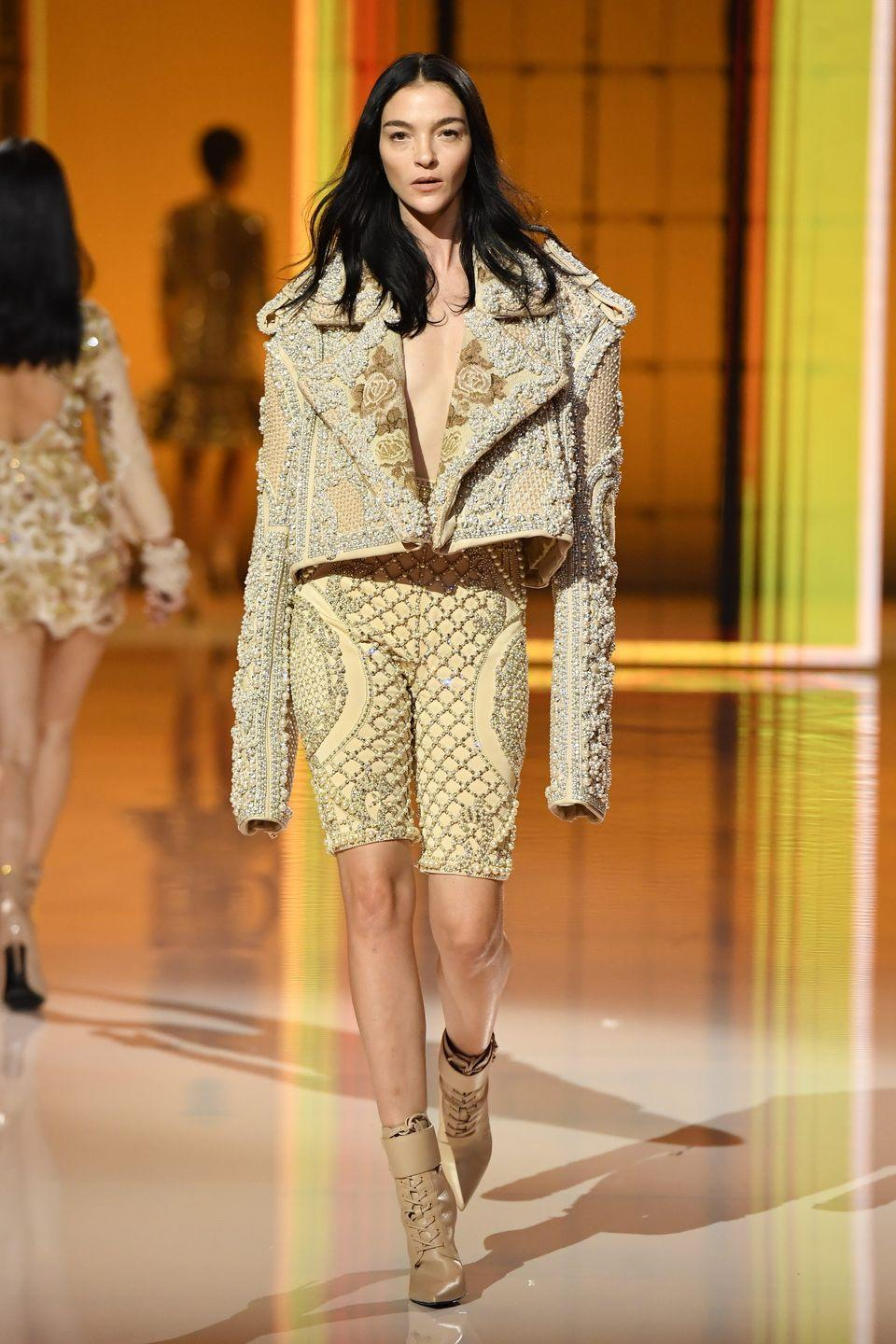 """<p>Last night, Olivier Rousteing celebrated 10 years at Balmain, presenting an anniversary collection, which featured new takes on some of his most famous pieces, from crystallised corsets to military-inspired jackets. The spectacle was supermodel-studded, and filled with emotional moments, including a recording from Beyoncé, which opened the show. </p><p>""""Over the next 10 years, I pledge to continue to push for more inclusion, more democracy and more openness,"""" Rousteing said. """"Here's to the next decade of sharing our joy-filled signature mix of fashion and music with more and more of those who wish to enter into the Balmain universe.""""</p><p><a href=""""https://www.harpersbazaar.com/uk/fashion/fashion-news/a37800643/balmain-beyonce-naomi-doja-kat/"""" rel=""""nofollow noopener"""" target=""""_blank"""" data-ylk=""""slk:Read, and see, more from the event here."""" class=""""link rapid-noclick-resp"""">Read, and see, more from the event here.</a></p>"""
