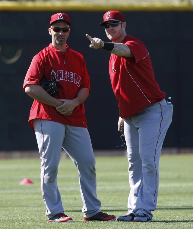 Los Angeles Angels left fielder Raul Ibanez (28), left, and Josh Hamilton (32) goof off during spring training baseball practice, Thursday, Feb. 20, 2014, in Tempe, Ariz. (AP Photo/Rick Scuteri)