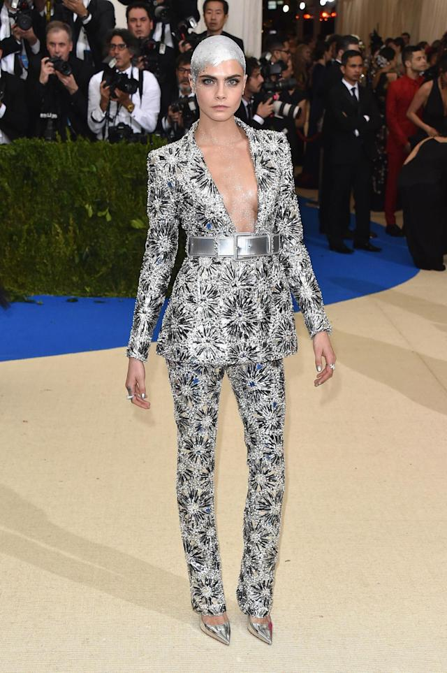 <p>In perhaps the most interesting beauty look of the night, model Cara Delevingne decorated her bald head with striking silver paint. (Photo by John Shearer/Getty Images) </p>