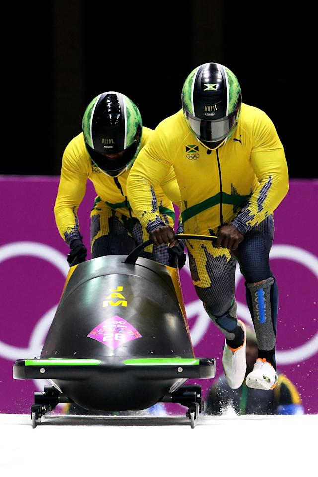 SOCHI, RUSSIA - FEBRUARY 16: Pilot Winston Watts and Marvin Dixon of Jamaica team 1 make a run during the Men's Two-Man Bobsleigh heats on Day 9 of the Sochi 2014 Winter Olympics at Sliding Center Sanki on February 16, 2014 in Sochi, Russia. (Photo by Alex Livesey/Getty Images)