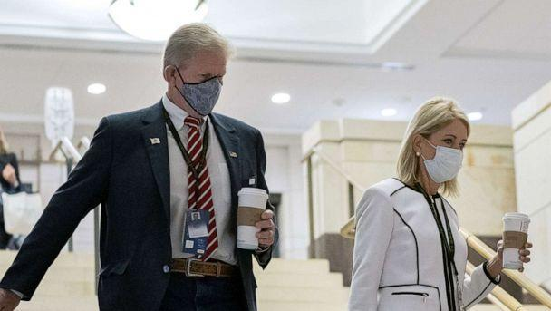 PHOTO: Representative-elect Chris Miller, a Republican from Illinois, left, and Representative-elect Mary Miller, a Republican from Illinois, center, wear protective masks while arriving to a new member briefing at the Capitol, Nov. 13, 2020. (Stefani Reynolds/Bloomberg via Getty Images)