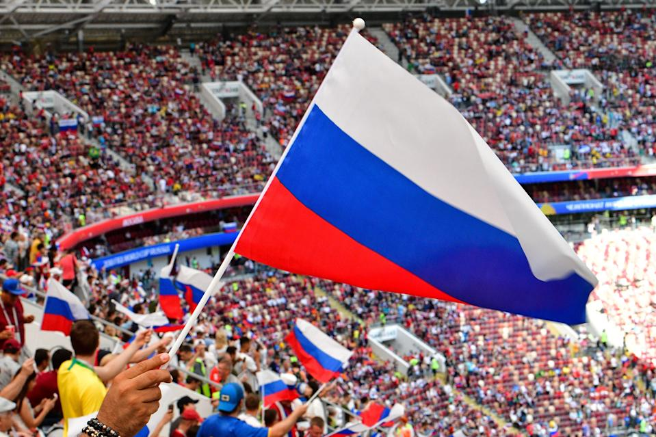 Russia supporters wave flags prior to the Russia 2018 World Cup round of 16 football match between Spain and Russia at the Luzhniki Stadium in Moscow on July 1, 2018. (Getty Images)