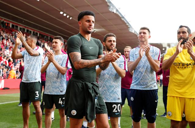 "Soccer Football - Premier League - Southampton vs Manchester City - St Mary's Stadium, Southampton, Britain - May 13, 2018 Manchester City's Kyle Walker and teammates applaud fans after the match Action Images via Reuters/John Sibley EDITORIAL USE ONLY. No use with unauthorized audio, video, data, fixture lists, club/league logos or ""live"" services. Online in-match use limited to 75 images, no video emulation. No use in betting, games or single club/league/player publications. Please contact your account representative for further details."