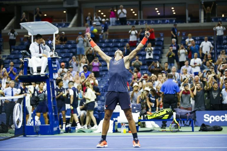 Hard won: Rafael Nadal celebrates his US Open quarter-final victory over Austrian Dominic Thiem