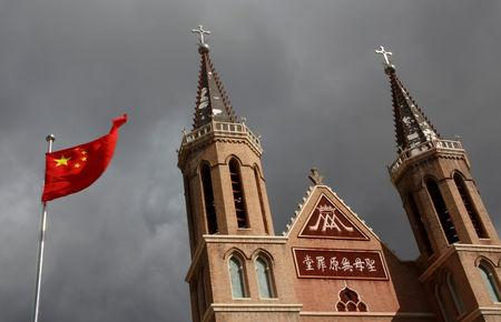 FILE PHOTO: The Chinese national flag flies in front of a Catholic underground church in the village of Huangtugang, Hebei province, China, September 30, 2018.  Picture taken September 30, 2018.   REUTERS/Thomas Peter/File Photo