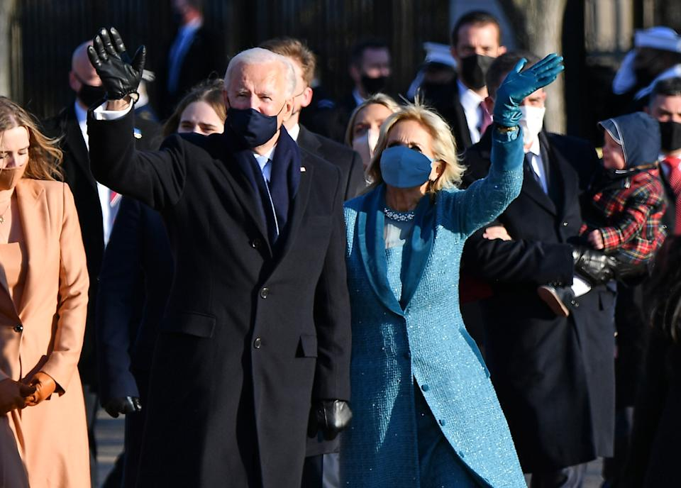 US President Joe Biden, First Lady Jill Biden and their family walk up Pennsylvania Avenue towards the White House in Washington, DC, after Biden and Kamala Harris were sworn in at the US Capitol on January 20, 2021.