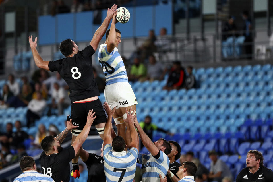 Argentina's Juan Martin Gonzalez, top right, wins a line out against New Zealand's Luke Jacobson during their Rugby Championship match on Sunday, Sept. 12, 2021, on the Gold Coast, Australia. (AP Photo/Tertius Pickard)