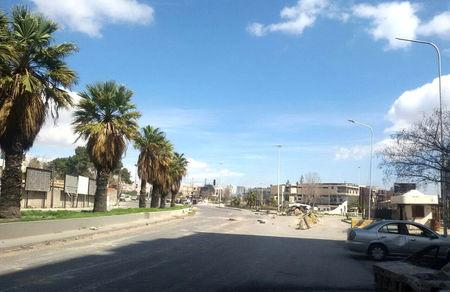 A view shows an empty street near the Abbasiyin area in the east of the capital Damascus