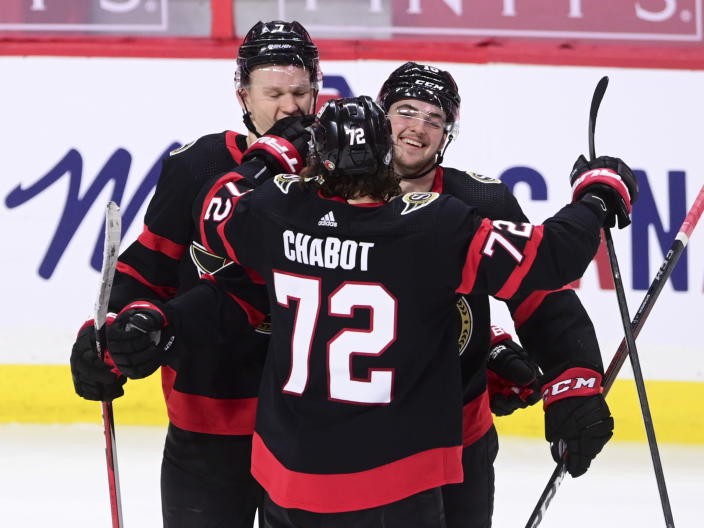 Ottawa Senators defenseman Thomas Chabot (72) and Brady Tkachuk (7) congratulate Drake Batherson (19) on his goal against the Calgary Flames during second period NHL hockey action in Ottawa on Monday, March 1, 2021. (Sean Kilpatrick/The Canadian Press via AP)