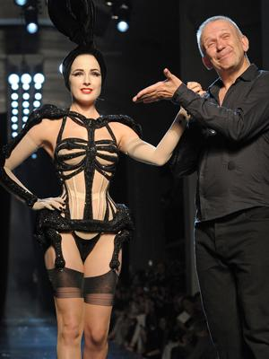 Burlesque beauty von Teese knows how to grab the audience's attention with and without clothes on. Here she is walking the walk in a barely there number for Jean-Paul Gaultier. GALLERY: Stras go geek chic