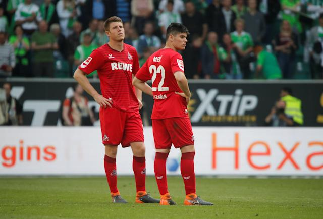 Soccer Football - Bundesliga - VfL Wolfsburg v FC Cologne - Volkswagen Arena, Wolfsburg, Germany - May 12, 2018 Cologne's Jorge Mere and Dominique Heintz look dejected after the match REUTERS/Wolfgang Rattay DFL RULES TO LIMIT THE ONLINE USAGE DURING MATCH TIME TO 15 PICTURES PER GAME. IMAGE SEQUENCES TO SIMULATE VIDEO IS NOT ALLOWED AT ANY TIME. FOR FURTHER QUERIES PLEASE CONTACT DFL DIRECTLY AT + 49 69 650050