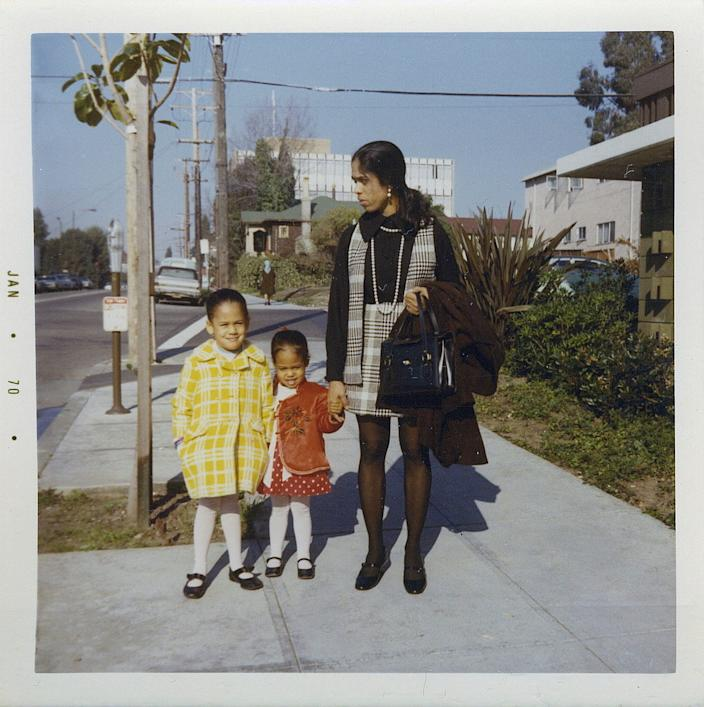 This January 1970 photo provided by the Kamala Harris campaign shows her, left, with her sister, Maya, and mother, Shyamala, outside their apartment in Berkeley, Calif., after her parents' separation.
