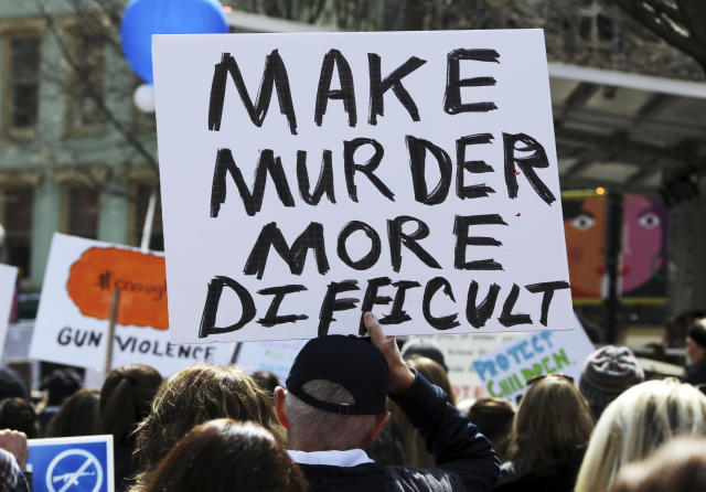 <p>A person holds a sign during a Gun Control Rally in Market Square in downtown Pittsburgh, PA. (AP Photo/Gene J. Puskar) </p>