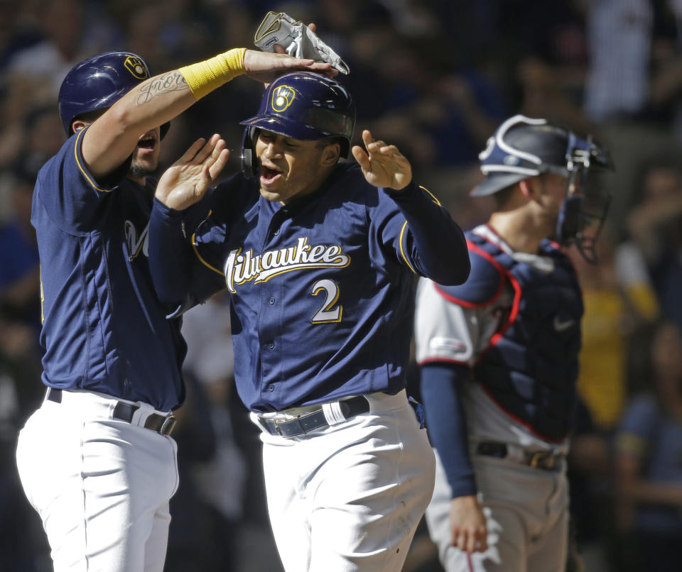 Milwaukee Brewers' Trent Grisham(2) reacts to his three-run home run against the Minnesota Twins during the eighth inning of a baseball game Wednesday, Aug. 14, 2019, in Milwaukee. (AP Photo/Jeffrey Phelps)