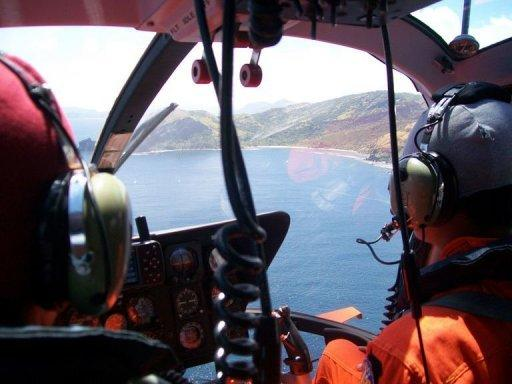 Members of the Basarnas team perform an aerial search for a missing boat