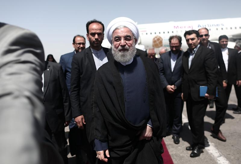 Current President Hassan Rouhani, who is seen as the frontrunner in unofficial polls, has vowed to work towards the removal of remaining sanctions and called for more time to allow the benefits of the deal to reach ordinary Iranians (AFP Photo/Behrouz MEHRI)