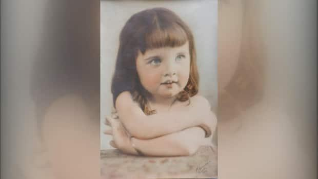 This photograph of a little girl, dated 1924 and signed by a well-known American photographer, has sparked a mystery after it was discovered in a Grande Cache, Alta., thrift shop. (Submitted by Elesa Willies - image credit)