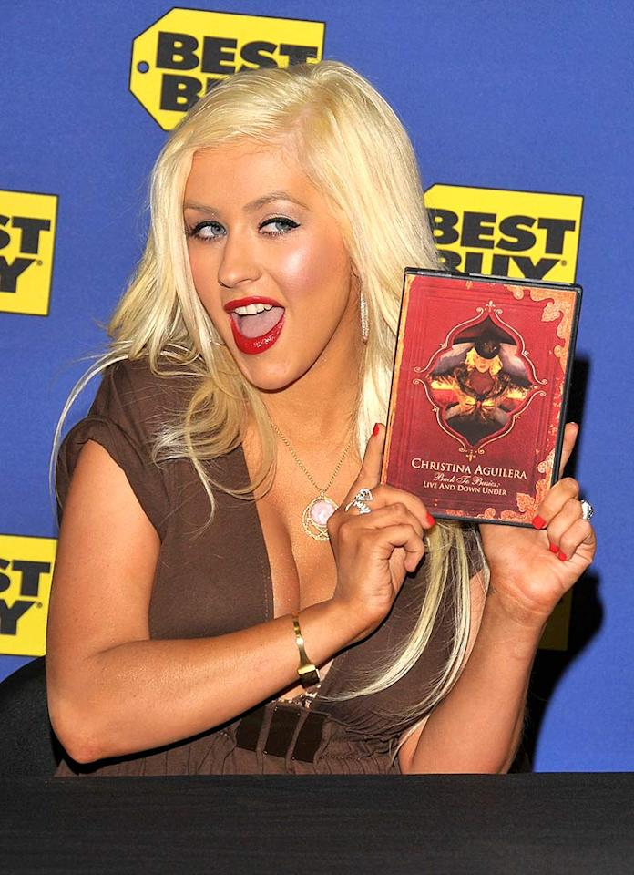 "Christina Aguilera made her first major public appearance since giving birth, promoting her new ""Back to Basics: Live and Down Under"" DVD Tuesday in West Hollywood. The new mom revealed that motherhood has inspired her to return to the recording studio. Lester Cohen/<a href=""http://www.wireimage.com"" target=""new"">WireImage.com</a> - February 5, 2008"
