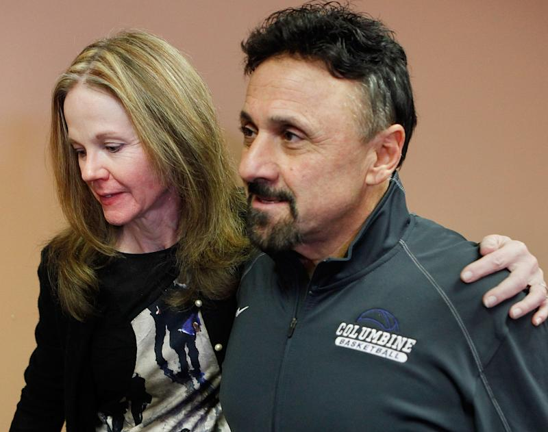 Frank DíAngelis, right, Columbine High School Principal at time of the 1999 school massacre and still principal today is comforted by long time friend Cindy Stevenson, Superintendent of JEFCO Schools after a news conference where Di'Angelis talked about the Connecticut School Shooting at Jefferson County School headquarters in Golden, Colo., on Thursday, Dec. 14, 2012.  In a state that was rocked by the 1999 Columbine school massacre and the Aurora movie theater shooting less than six months ago, Friday's shootings renewed debate over why mass shootings keep occurring and whether gun control can stop them.  (AP Photo/Ed Andrieski)