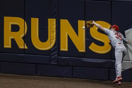 St. Louis Cardinals' Lane Thomas can't catch a ball hit by Milwaukee Brewers' Jedd Gyorko during the fifth inning of a baseball game Tuesday, Sept. 15, 2020, in Milwaukee. (AP Photo/Morry Gash)