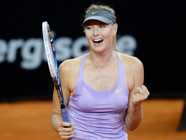 Russia's Maria Sharapova celebrates after winning her semifinal match against Sara Errani of Italy at the Porsche tennis Grand Prix in Stuttgart, Germany, Saturday, April 26, 2014. Sharapova won the match with 6-1 and 6-2. (AP Photo/dpa, Bernd Weissbrod)