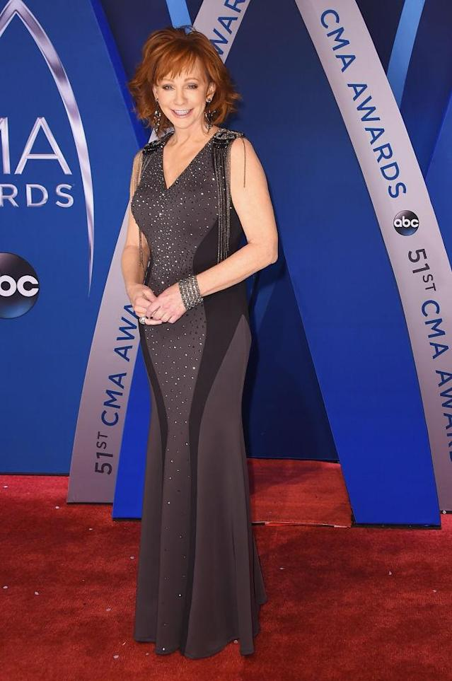 <p>The 62-year-old looks beautiful in a dual-toned gray dress with embellished shoulders. (Photo: Getty Images) </p>