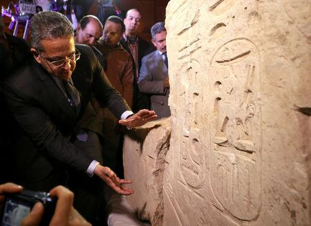 Egyptian Minister of Antiquities Khaled Al-Anani stands beside the collosus explaining new evidence pointing to it depicting Psammetich I in Cairo, Egypt, March 16, 2017. REUTERS/Mohamed Abd El Ghany
