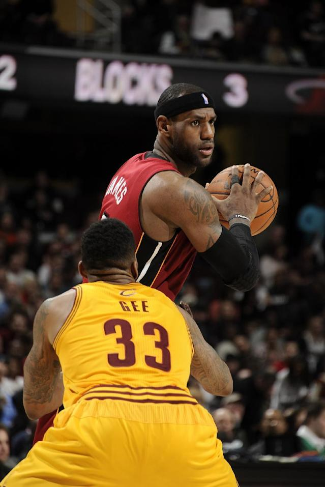 CLEVELAND, OH - MARCH 18: LeBron James #6 of the Miami Heat controls the ball against Alonzo Gee #33 of the Cleveland Cavaliers at The Quicken Loans Arena on March 18, 2014 in Cleveland, Ohio. (Photo by David Liam Kyle/NBAE via Getty Images)