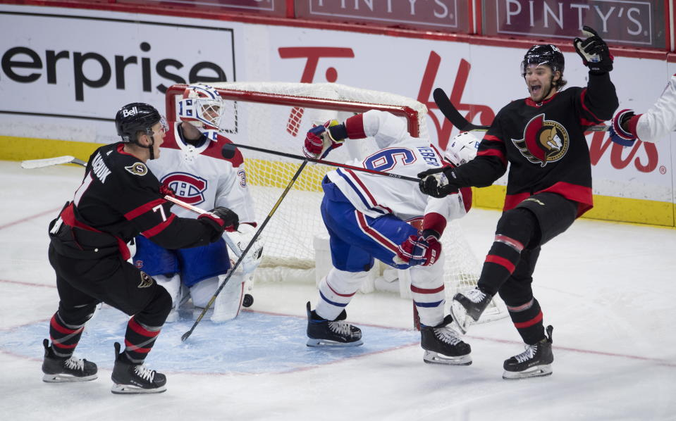 Ottawa Senators left wing Brady Tkachuk (7) races to congratulate teammate center Josh Norris, right, who celebrates his goal while Montreal Canadiens goaltender Jake Allen and defenseman Shea Weber (6) look on during third-period NHL hockey game action Sunday, Feb. 21, 2021, in Ottawa, Ontario. (Adrian Wyld/The Canadian Press via AP)