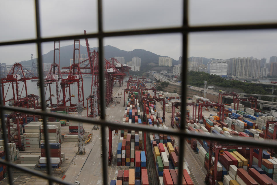 Shipping containers are seen at the port of Kwai Tsing Container Terminals in Hong Kong, Friday, May 24, 2019. Kwai Tsing Container Terminals is one of the busiest ports in the world. (AP Photo/Kin Cheung)
