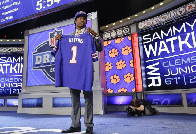 Clemson wide receiver Sammy Watkins poses for photos after being selected by the Buffalo Bills as the fourth round pick in the first round of the 2014 NFL Draft, Thursday, May 8, 2014, in New York. (AP Photo/Craig Ruttle)