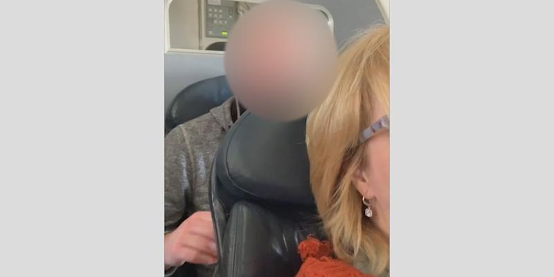 Airline passenger films man punching her economy seat after she reclines
