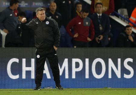 Leicester City manager Craig Shakespeare celebrates after the game