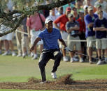 <p>Tiger Woods nearly falls backwards after hitting out of the rough on the 17th hole during the third round of the Masters golf tournament Saturday, April 9, 2011, in Augusta, Ga. (AP Photo/Chris O'Meara) </p>