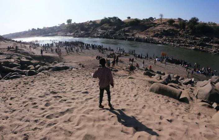Ethiopians are seen at the Setit River on the Sudan-Ethiopia border in Hamdait village in eastern Kassala state