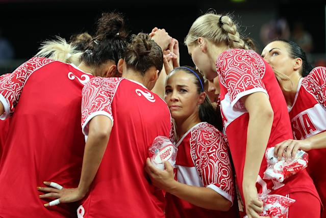 LONDON, ENGLAND - AUGUST 01: Becky Hammon #9 of Russia huddles up with teammates before the Women's Basketball Preliminary Round match against Great Britain on Day 5 of the London 2012 Olympic Games at Basketball Arena on August 1, 2012 in London, England. (Photo by Christian Petersen/Getty Images)