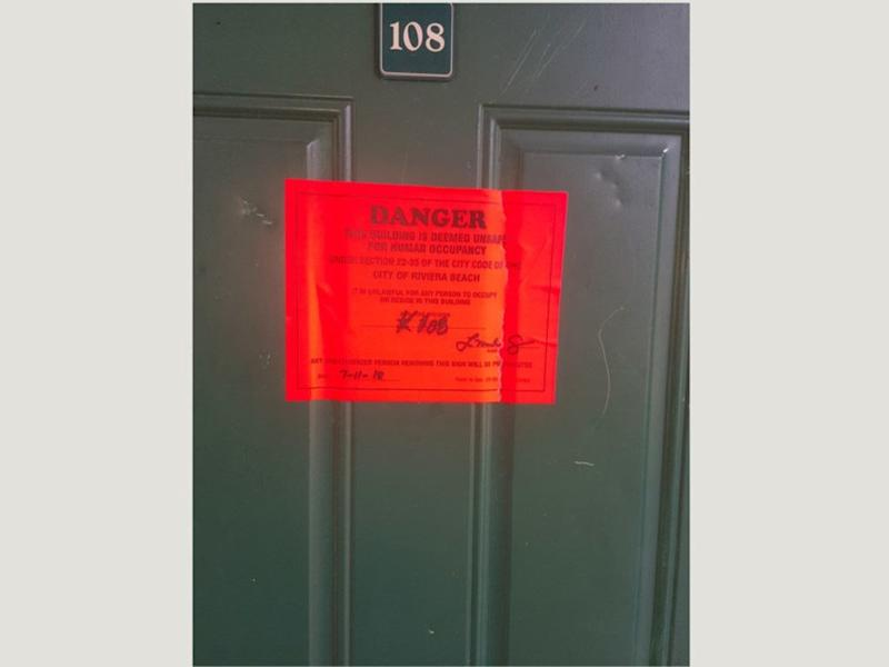 Unsafe notice on the door of one of the 36 apartments marked unsafe for human occupancy at Stonybrook Apartments. Courtesy photo