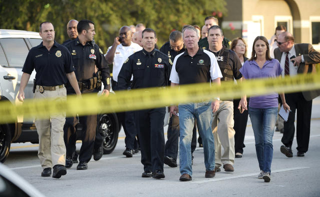 <p>Orlando Mayor Buddy Dyer, center right, and Orlando Police Chief John Mina, center left, arrive to a news conference after a fatal shooting at Pulse Orlando nightclub in Orlando, Fla., June 12, 2016. (AP Photo/Phelan M. Ebenhack) </p>