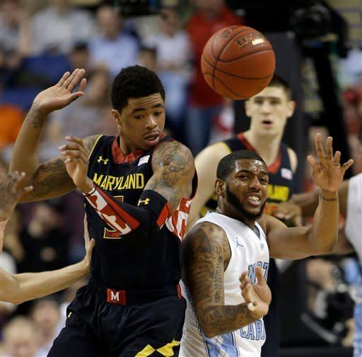 Maryland's Nick Faust, left, and North Carolina's Leslie McDonald, right, battle for a rebound during the first half of an NCAA college basketball game in the semifinals of the Atlantic Coast Conference tournament in Greensboro, N.C., Saturday, March 16, 2013. (AP Photo/Bob Leverone)