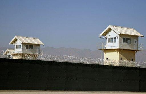 Watchtowers along the perimeter of the Bagram prison, north of Kabul in 2009. The United States on Friday signed a deal transferring the controversial Bagram prison to Afghan control, marking a breakthrough in negotiations over a strategic treaty between the two nations