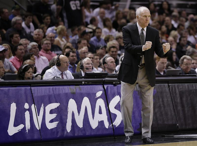 San Antonio Spurs coach Gregg Popovich talks to his players during the first half of Game 5 of the Western Conference finals NBA basketball playoff series against the Oklahoma City Thunder, Thursday, May 29, 2014, in San Antonio