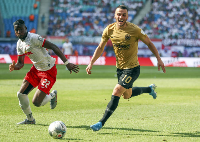 Leipzig's Nordi Mukiele, left, and Frankfurt's Filip Kostic battle for the ball during the German Bundesliga soccer match between RB Leipzig and Eintracht Frankfurt in Leipzig, Germany, Sunday, Aug. 25, 2019. (Jan Woitas/dpa via AP)