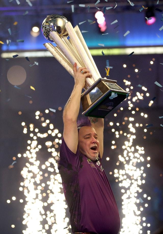 Peter Wright lifts the Sid Waddell Trophy