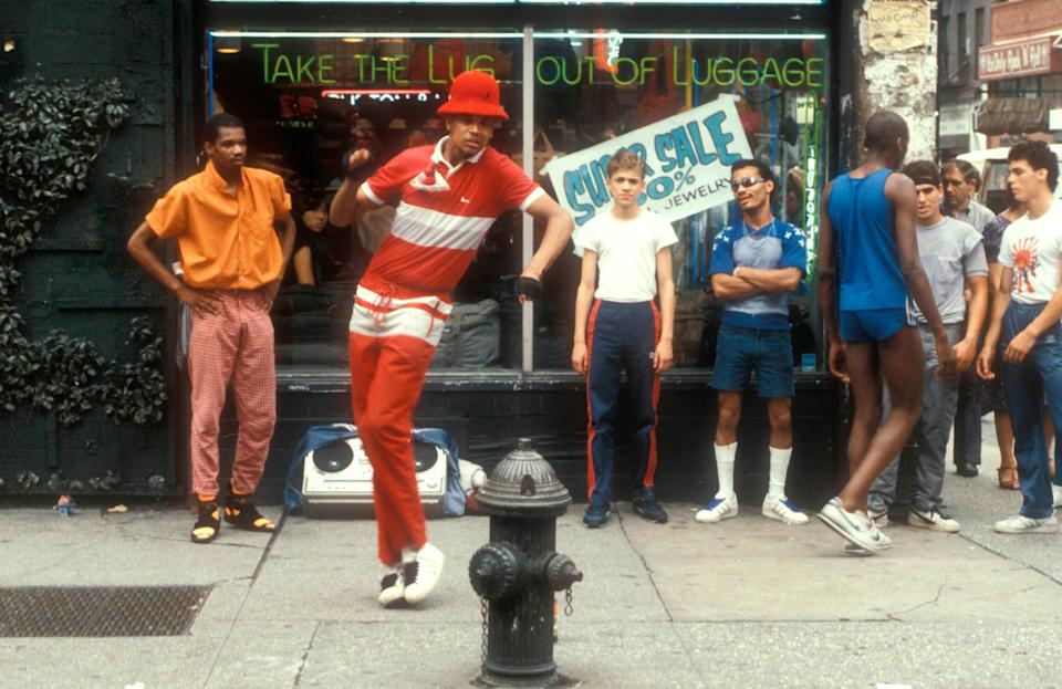 "Breakdancers, or ""B-Boys,"" perform on a sidewalk in Greenwich Village. The dance craze, which took hold in New York City in the 1970s, has since become a worldwide phenomenon."