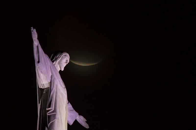 The blood moon rises above the Christ the Redeemer statue in Rio de Janeiro, Jan. 21.
