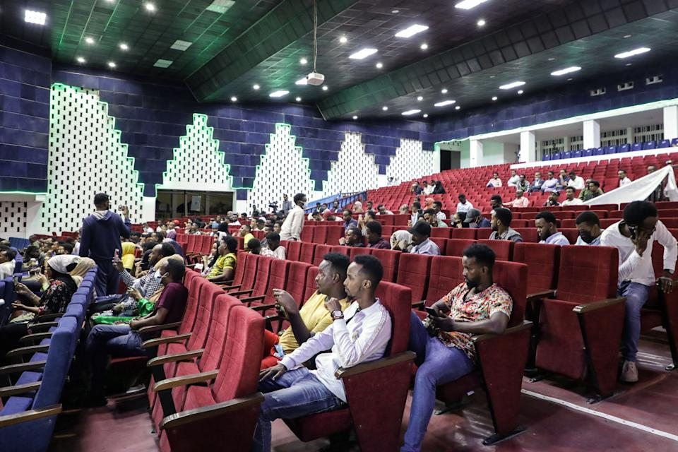 Viewers wait for the first screening of Somali films at The Somali National Theatre in Mogadishu, on September 22, 2021, which has been opened for the first time to public after its inauguration in 2020. / AFP / Abdirahman YUSUF