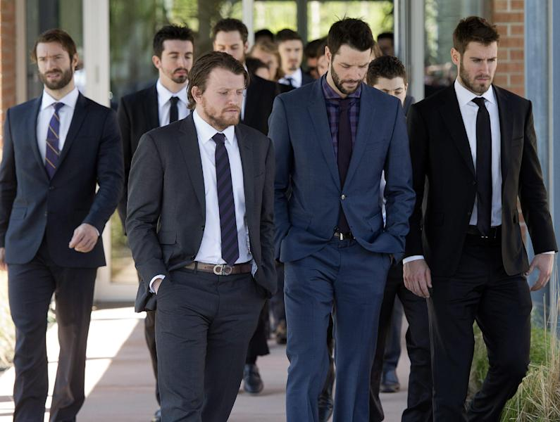 New York Rangers players leave a funeral home following service's for the mother of teammate Martin St. Louis, Sunday, May 18, 2014, in Laval, Quebec. (AP Photo/The Canadian Press, Ryan Remiorz)