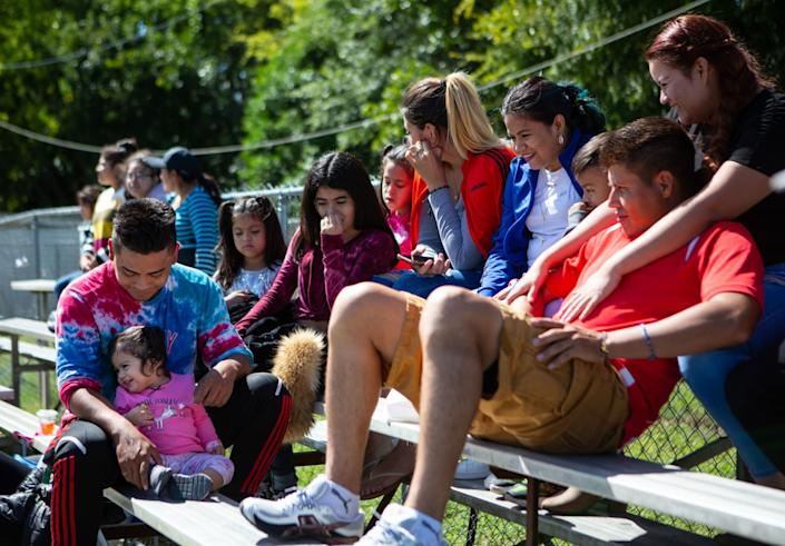 Families gather to enjoy a soccer game in Raleigh, N.C.