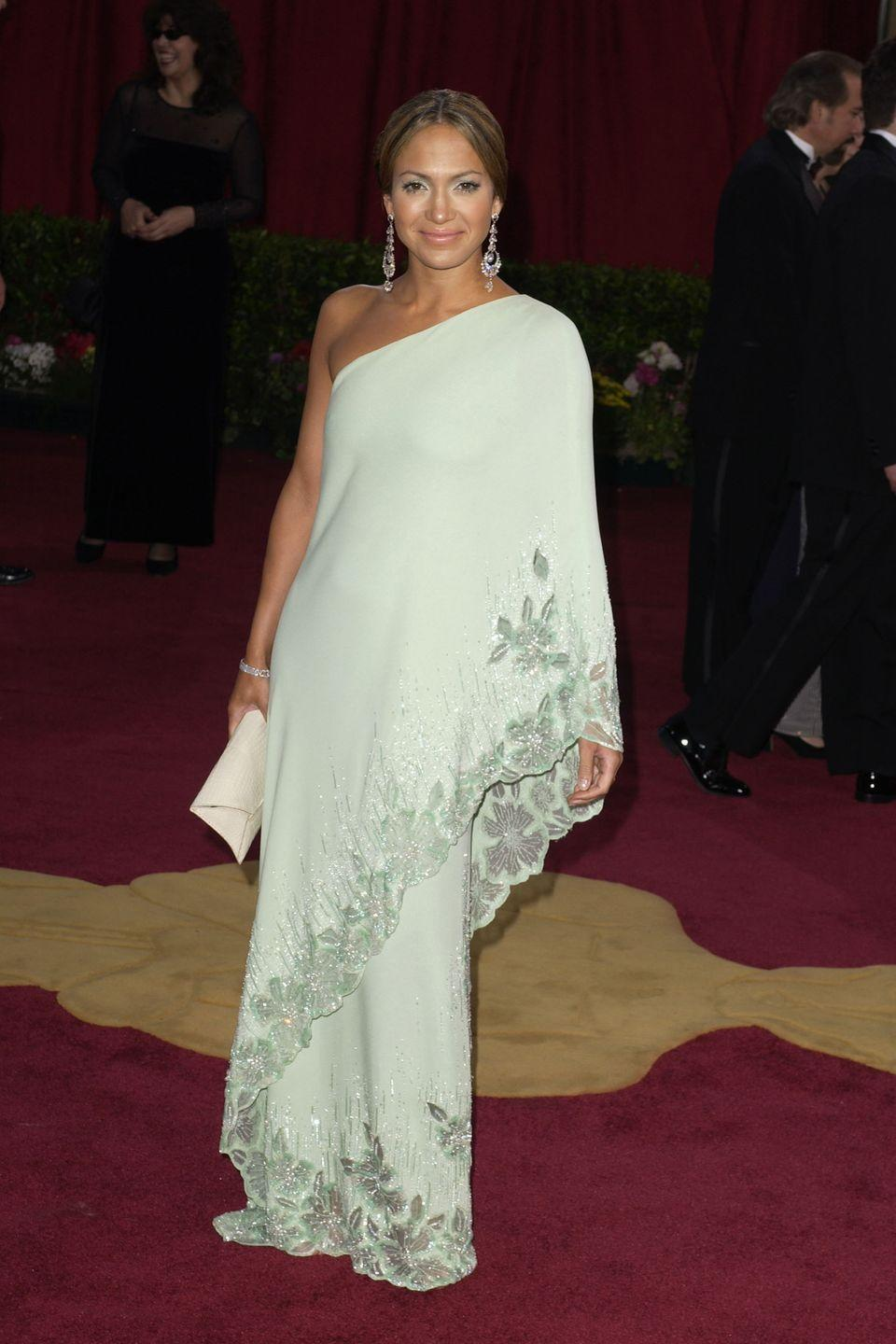 <p>While the shape of the Valentino dress Jennifer Lopez wore to the 2003 Academy Awards is quite different from Tiana's voluminous ballgown, the mint green color and the floral motifs are spot-on.</p>